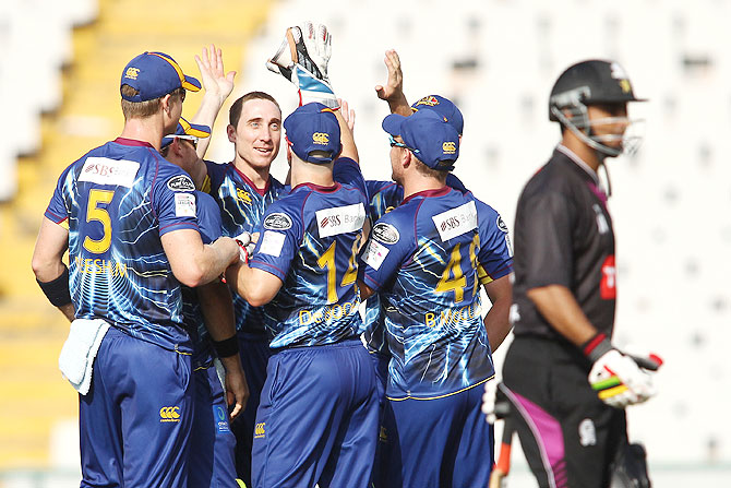 James McMillan of Otago Volts is congratulated by teammates after dismissing Ammar Mahmood Khan