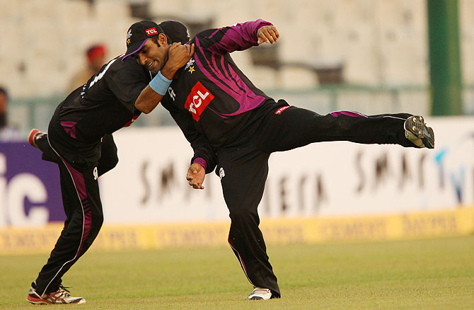 Asif Ali and Imran Khalid of Faisalabad Wolves celebrate the wicket of Hamish Rutherford