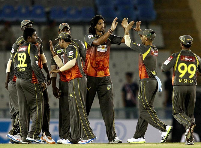 Ishant Sharma (centre) celebrates with team mates after taking the wicket of Upul Tharanga