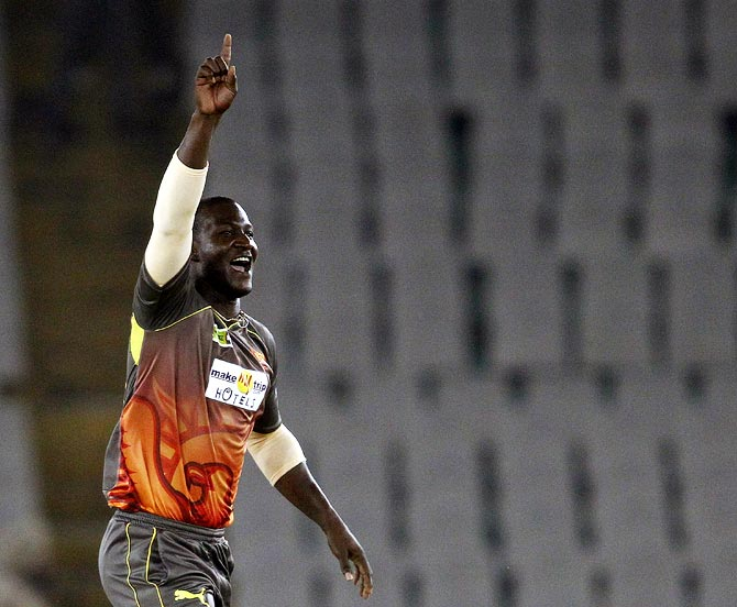 Darren Sammy celebrates after picking up the wicket of Shehan Jayasuriya