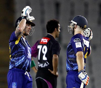 Otago Volts captain Brendon McCullum and Derek de Boorder of Otago Volts celebrate after victory in clinched