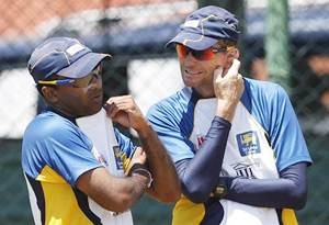 Sri Lanka captain Mahela Jayawardene (left) talks with coach Graham Ford during a practice session