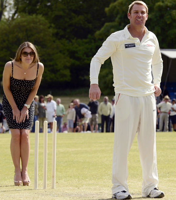 Elizabeth Hurley and Shane Warne look on