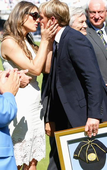 Shane Warne is congratulated by Elizabeth Hurley