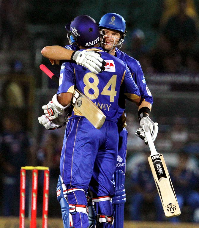 Shane Watson congratulates Stuart Binny after winning the match