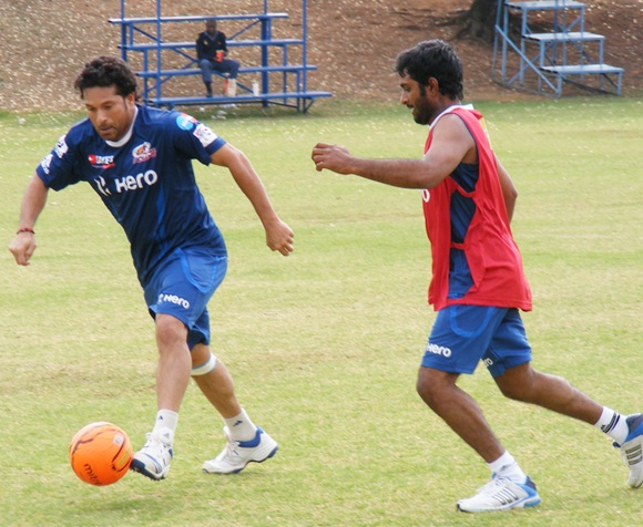Sachin Tendulkar plays a game of football