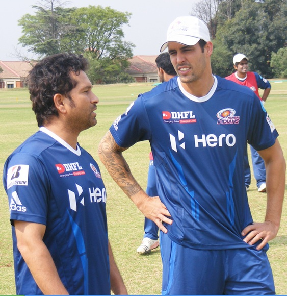 Sachin Tendulkar with Mitchell Johnson