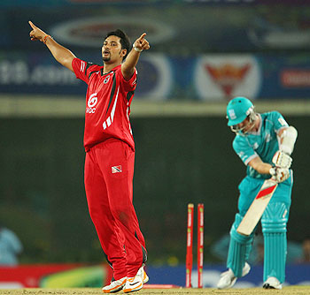 Ravindarnath Rampaul of Trinidad & Tobago celebrates the wicket of Alister McDermott of Brisbane Heat on Sunday