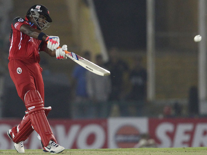 Darren Bravo hits over the top for a boundary
