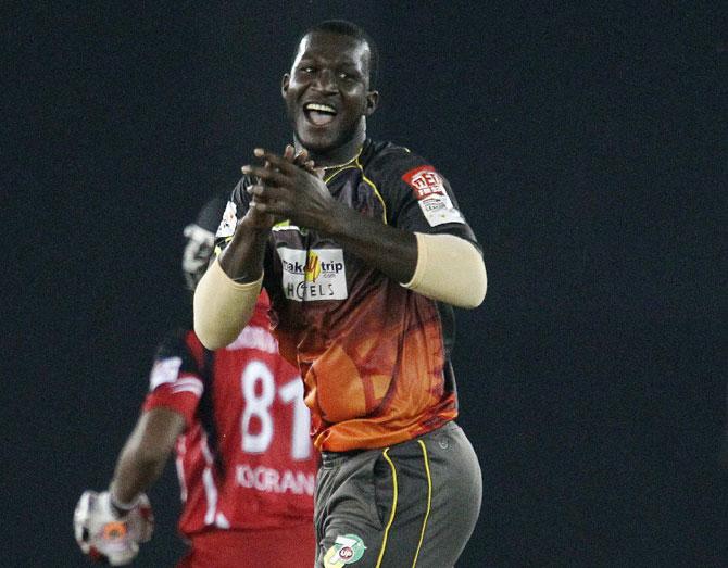 Darren Sammy of Sunrisers Hyderabad celebrates the wicket of Nicholas Pooran of Trinidad & Tobago