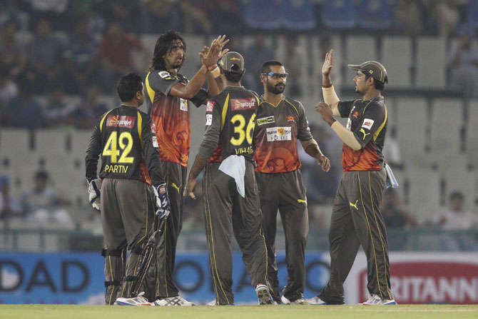 Ishant Sharma is congratulated by his team mates after getting Evin Lewis