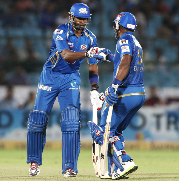 Kieron Pollard of Mumbai Indians congratulates teammate Dwayne Smith