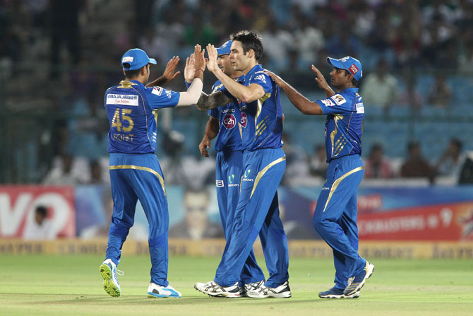 Mumbai Indians captain Rohit Sharma congratulates Mitchell Johnson