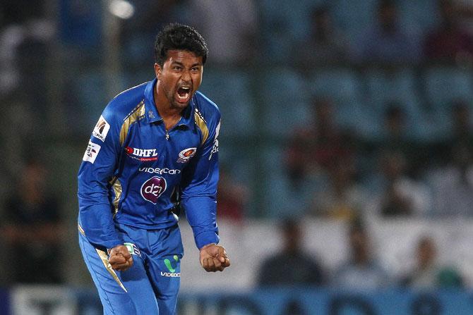 Pragyan Ojha of Mumbai Indians celebrates a wicket