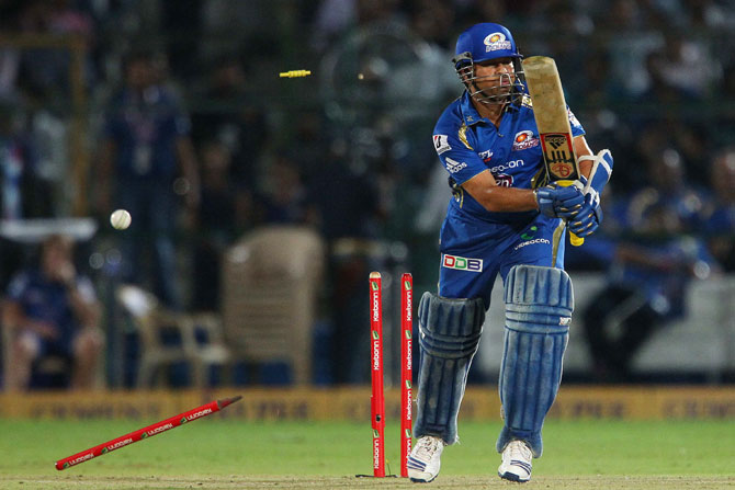 Sachin Tendulkar of Mumbai Indians has his stumps split by Sohail Tanveer of the Highveld Lions