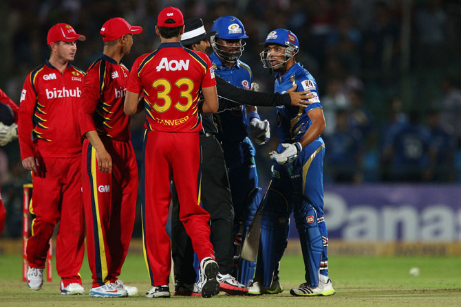 Mumbai Indians captain Rohit Sharma has words with the umpire after a clash with Hardus Viljoen of the Highveld Lions