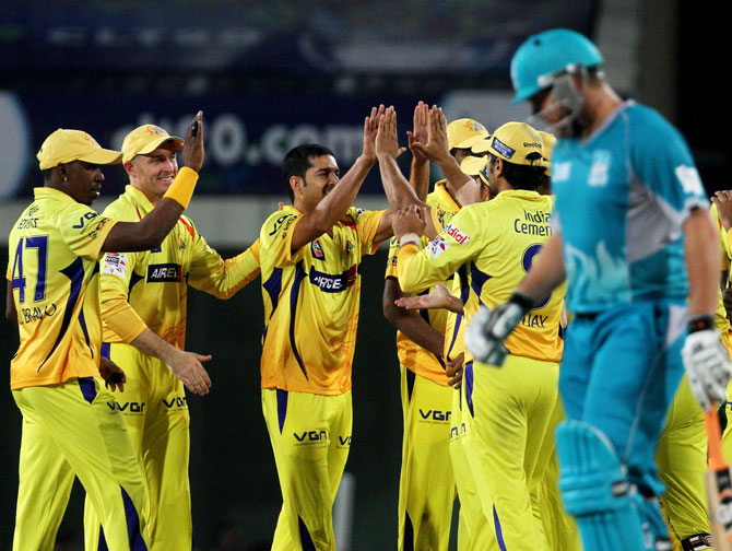 Chennai Super King players celebrate after the wicket of Brisbane Heat player Dominic Michael