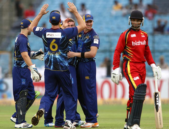 Otago Volts players congratulates Nicholas Beard after he took the wicket of Alviro Petersen