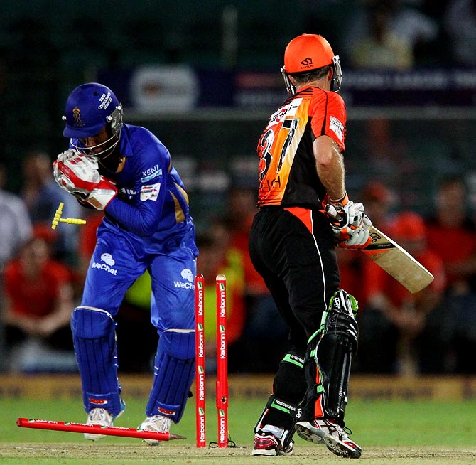 Simon Katich is stumped by wicketkeeper Sanju Samson