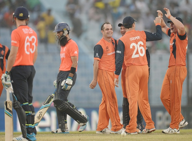 Peter Borren of the Netherlands celebrates with Wesley Barresi and   Tom Cooper after dismissing Moeen Ali of England during the ICC World Twenty20 match