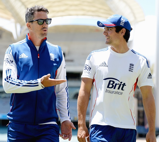Kevin Pietersen speaks with England captain Alastair Cook
