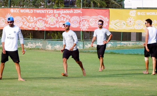 From left, Ravindra Jadeja, Ajinkya Rahane, Virat Kohli and Yuvraj Singh play barefoot football during a training session in Mirpur, Bangladesh, on Tuesday.