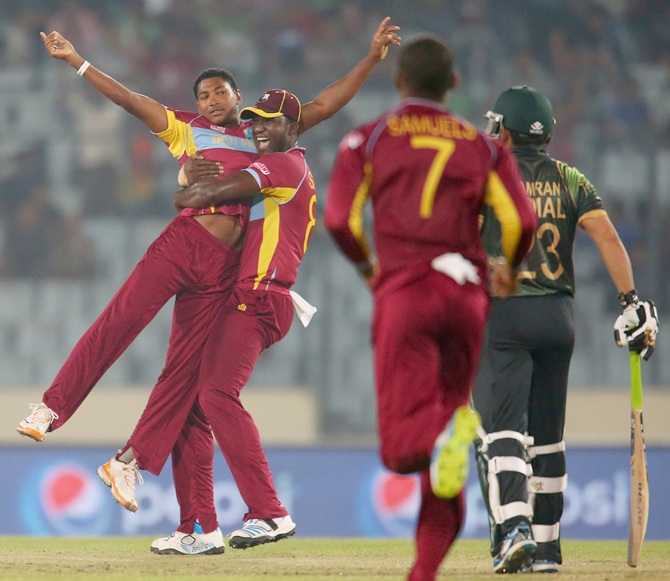 Krishmar Santokie is congratulated by Darren Sammy