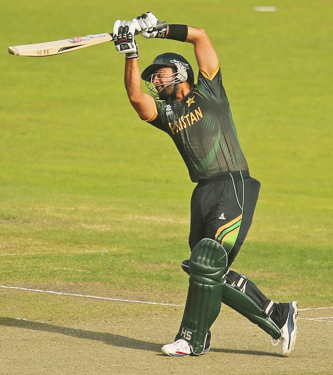 Pakistan's Ahmed Shehzad hits a six