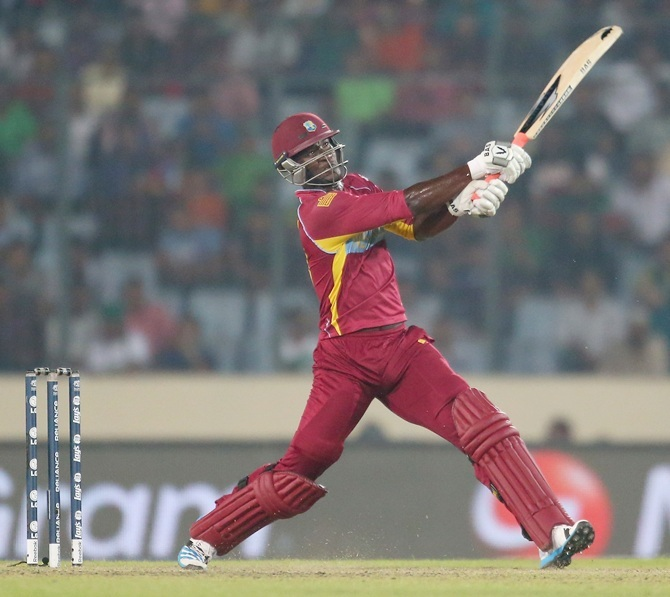 Darren Sammy hits a six during the match against Pakistan