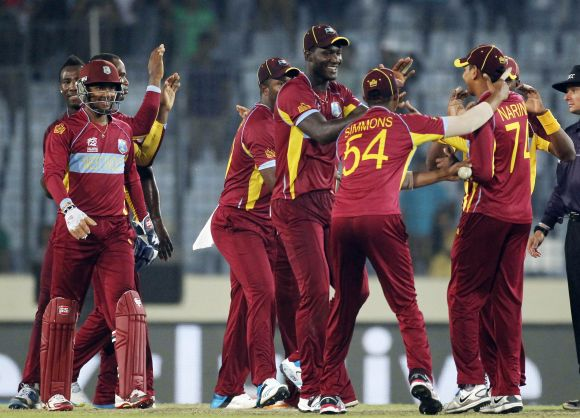 West Indies players celebrate after winning the game