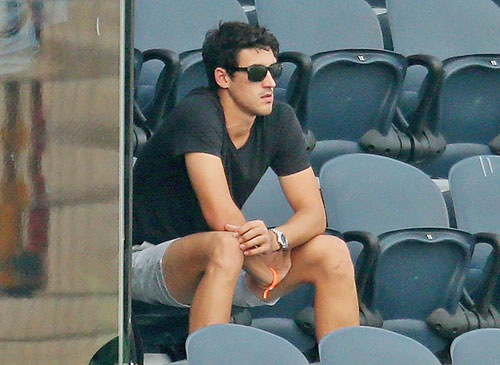 Mitchell Starc looks on from the stands during the ICC women's World T20 semi-final between Australia and West Indies