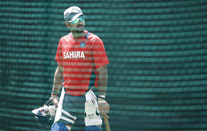 Yuvraj Singh leaves after batting in the nets during a practice session