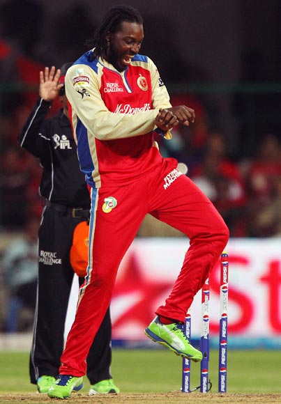 Chris Gayle celebrates taking a wicket
