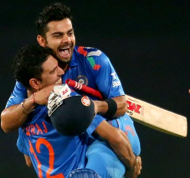 Virat Kohli is hugged by Yuvraj Singh after hitting the winning runs against South Africa in the ICC World Twenty20 semi-final.