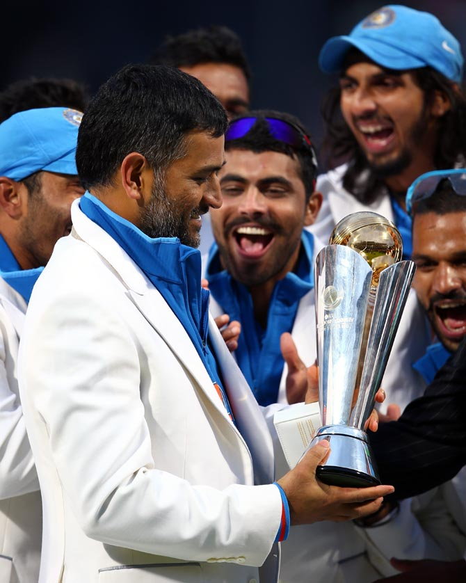 Mahendra Singh Dhoni celebrates with his team after winning the ICC Champions Trophy in June 2013.