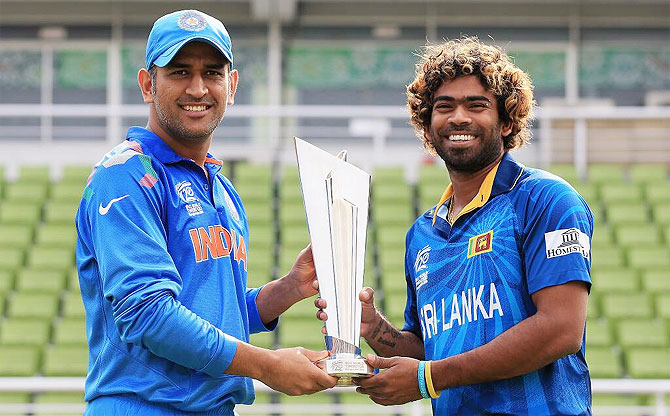 India captain MS Dhoni and Sri Lanka's Lasith Malinga with the World T20 Championship trophy in Mirpur, Dhaka on Saturday