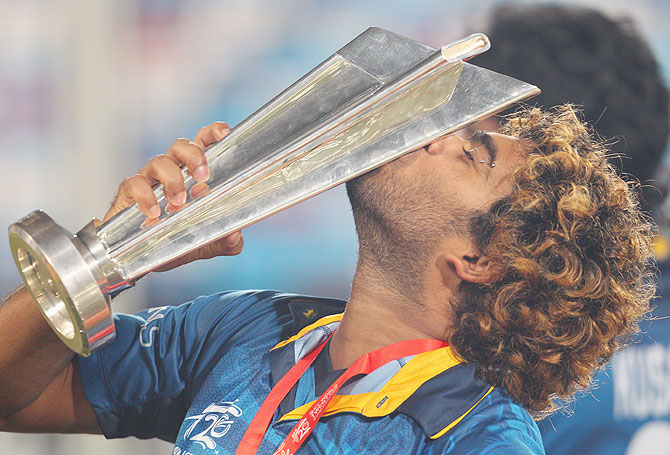 Sri Lanka's stand-in captain Lasith Malinga celebrates with the World T20 trophy on Sunday