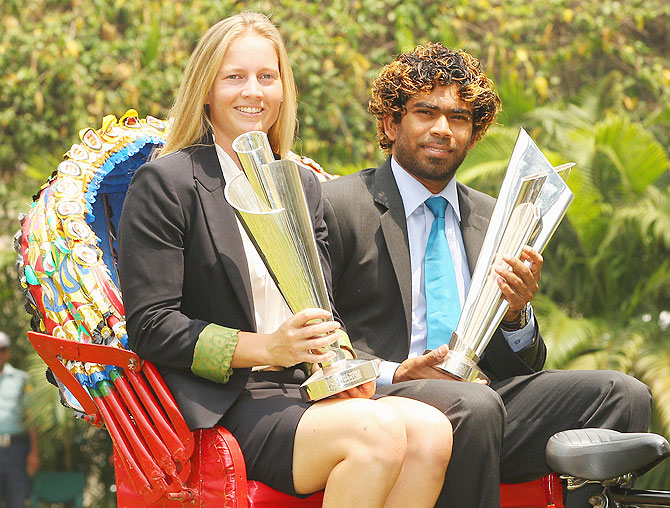 Meg Lanning, captain of Australia and Lasith Malinga, captain of Sri Lanka pose with the trophies on a rickshaw during a photocall after winning the final of the ICC Women's and Men's World Twenty20 in Bangladesh on Sunday