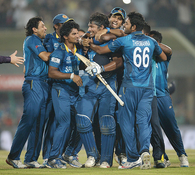 Kumar Sangakkara of Sri Lanka is mobbed by teammates in celebration after winning the ICC World Twenty20 title on Sunday