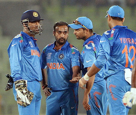 Amit Mishra celebrates the fall of a wicket