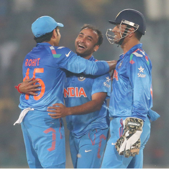 Amit Mishra celebrates with Rohit Sharma and MS Dhoni