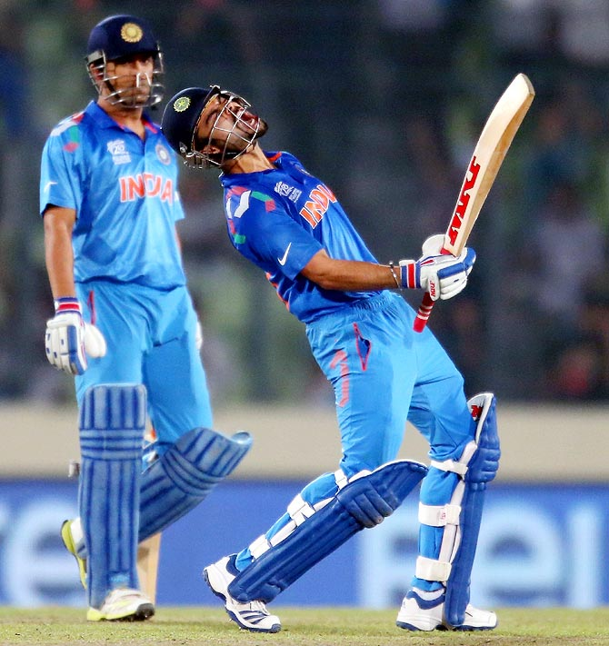 Virat Kohli (right) celebrates victory against South Africa as India captain Mahendra Singh Dhoni looks on