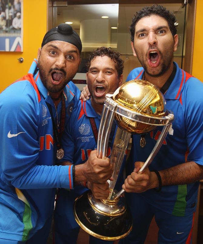 Harbhajan Singh (left),Sachin Tendulkar (centre) and Yuvraj Singh celebrate with the 2011 World Cup trophy.