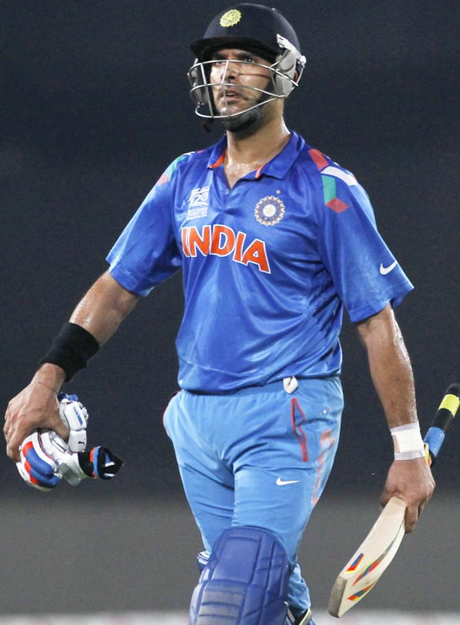 India's Yuvraj Singh leaves the field after being dismissed