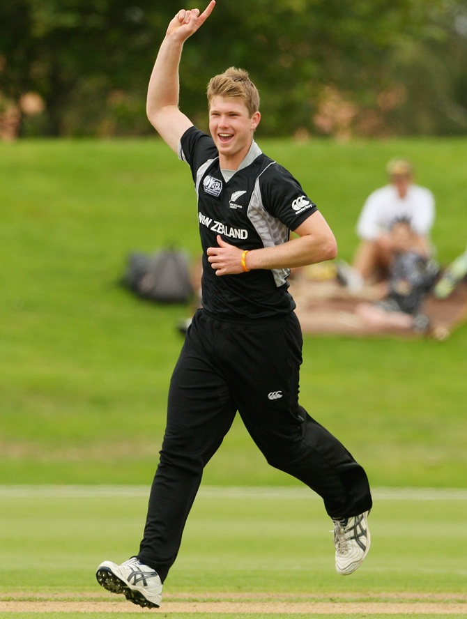 Jimmy Neesham of New Zealand celebrates