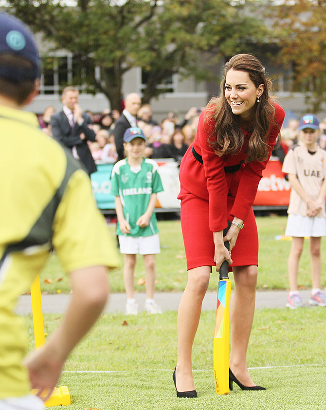 Duchess of Cambridge, Catherine 'Kate' Middleton, takes guard against the bowling of husband and Duke of Cambridge Prince William, during the countdown to the 2015 ICC Cricket World Cup at Latimer Square in Christchurch, New Zealand on Monday