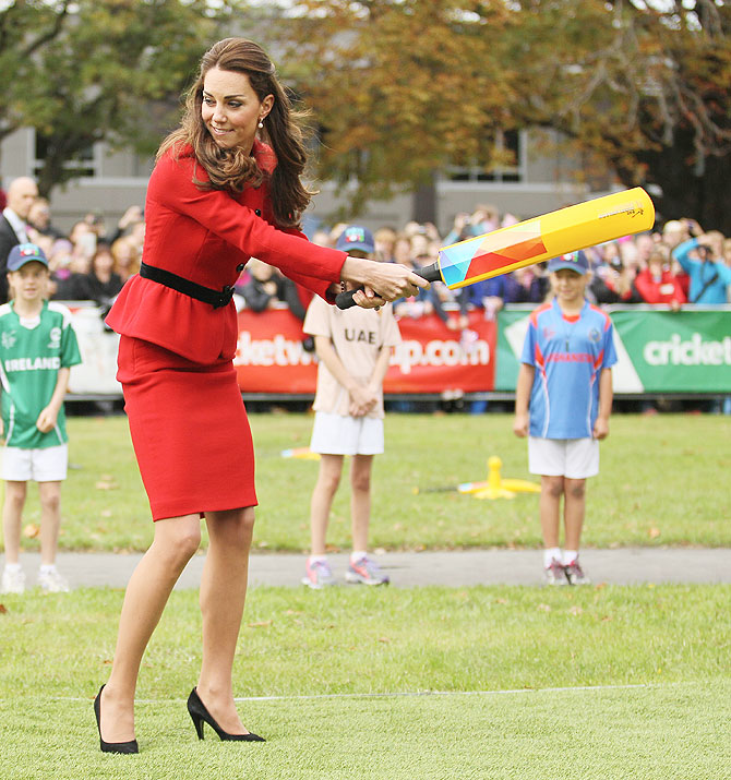 Kate Middleton swings wildly as she faces some 'fierce' bowling from husband Prince William