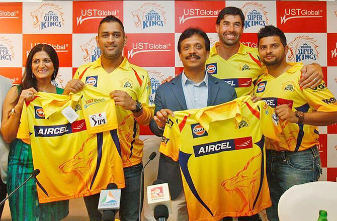 Chennai Super Kings captain MS Dhoni with teammate Suresh Raina and coach Stephen Fleming at the launch of the new sponsor logo on the team jersey on Monday
