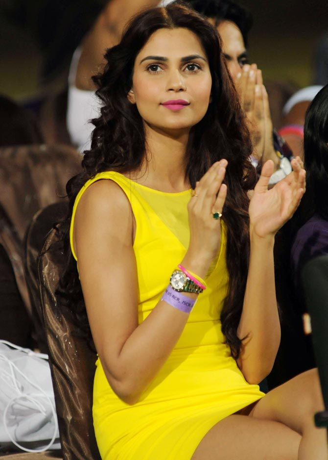 A Chennai Super Kings fan cheers for her team during IPL 6