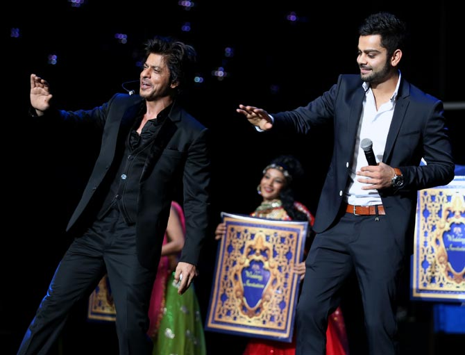 Virat Kohli (right) shakes a leg with Shah Rukh Khan